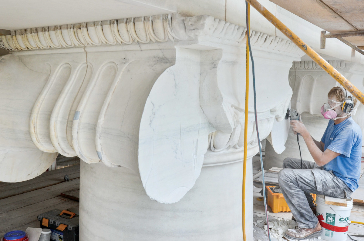 During photos of marble column capital restoration.