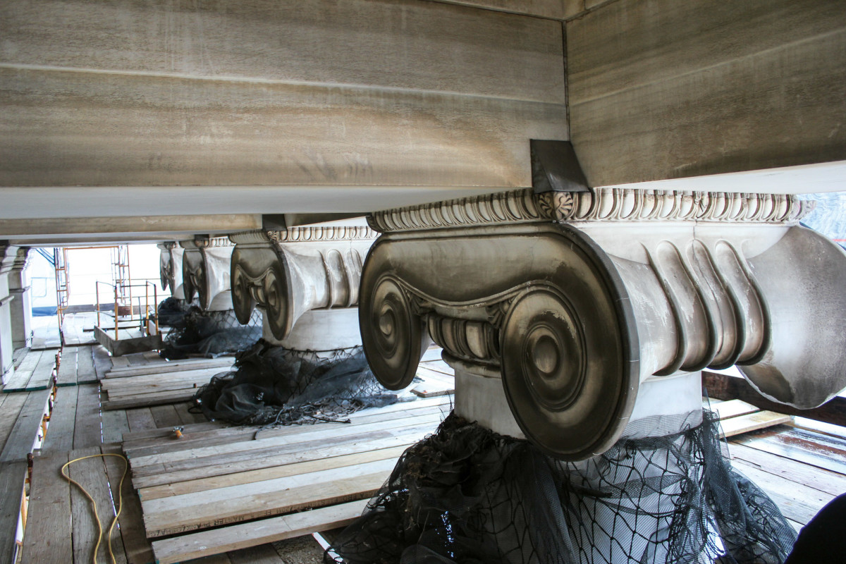Before photos of marble column capital restoration, including a complex dutchman repair to the volutes.
