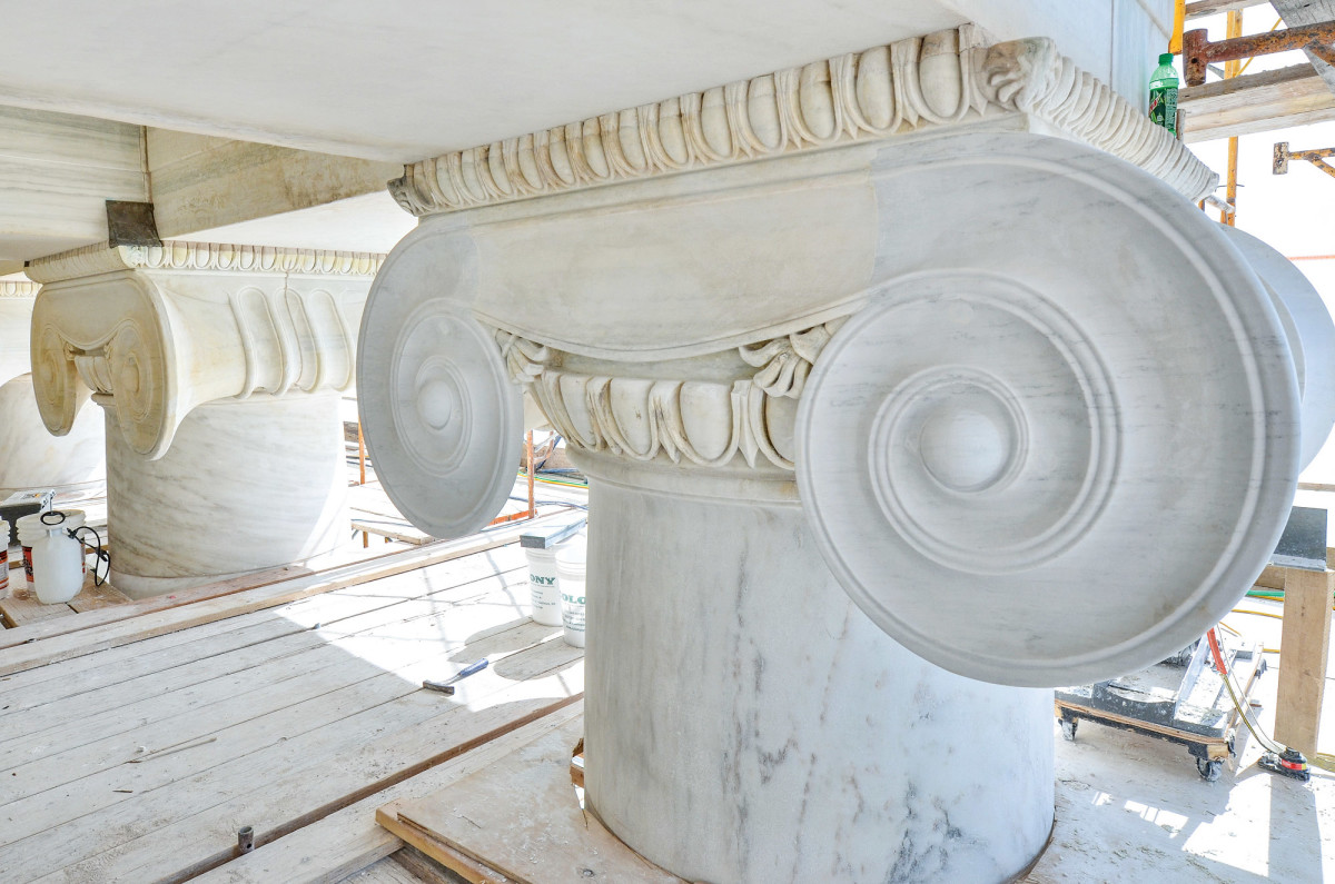 After photos of marble column capital restoration, including a complex dutchman repair to the volutes.