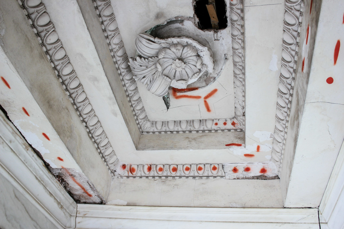 The ceilings within the front temple portico before and after intense plaster restoration and refinishing.