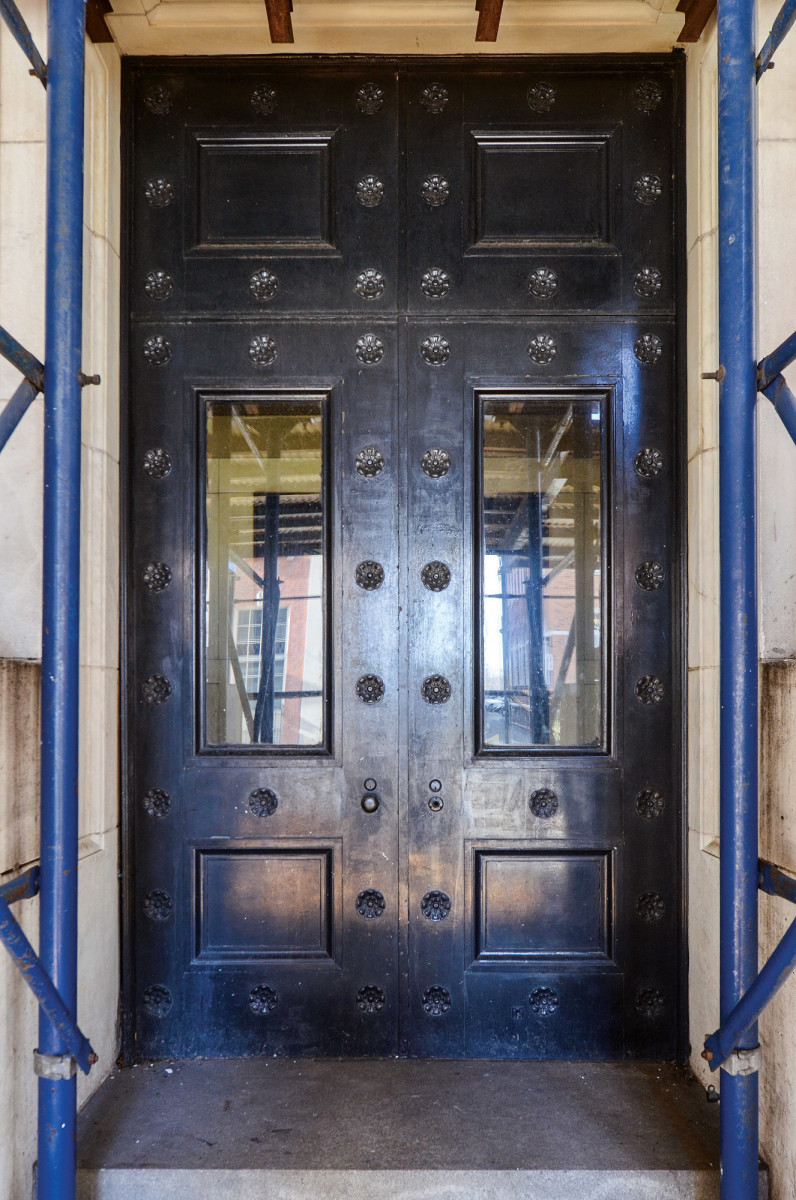 Several original bronze exterior doors had been replaced in years past.