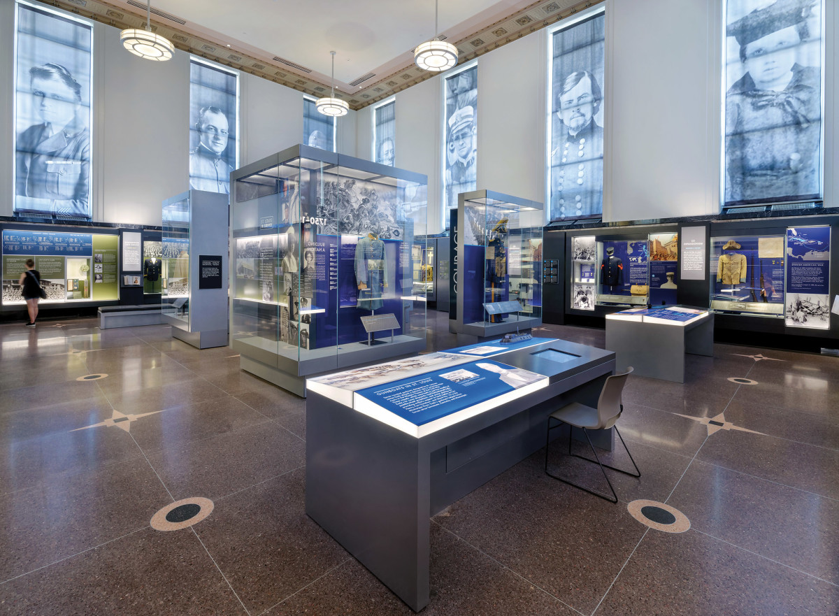 The exhibit halls feature restored terrazzo floors, plaster ceilings, and light fixtures.  Window shades over the original aluminum windows feature local soldiers and contribute to the story told through the new exhibits.