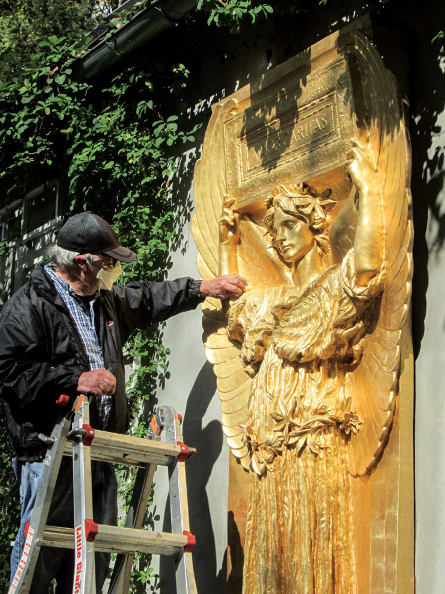 "Robert Shure cleans Augustus Saint-Gaudens' ""Amor Caritas"" or ""Angel with a Tablet"", sculpted memorial"