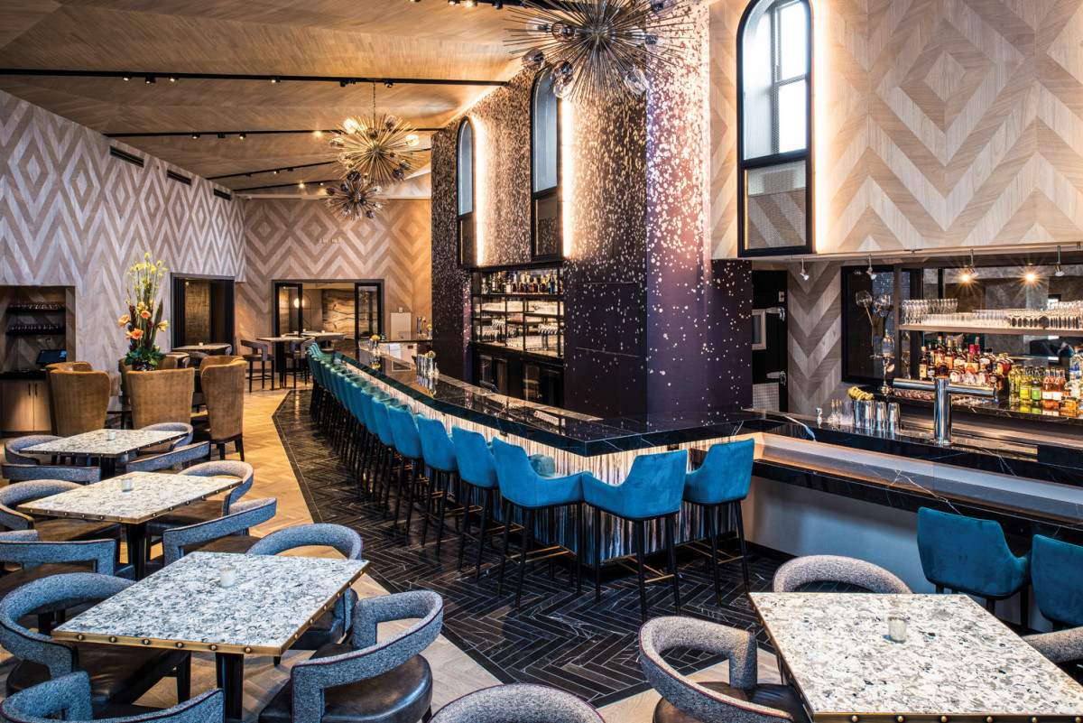 The indoor bar on Floor 21 is one of the amenities of the tri-level rooftop.