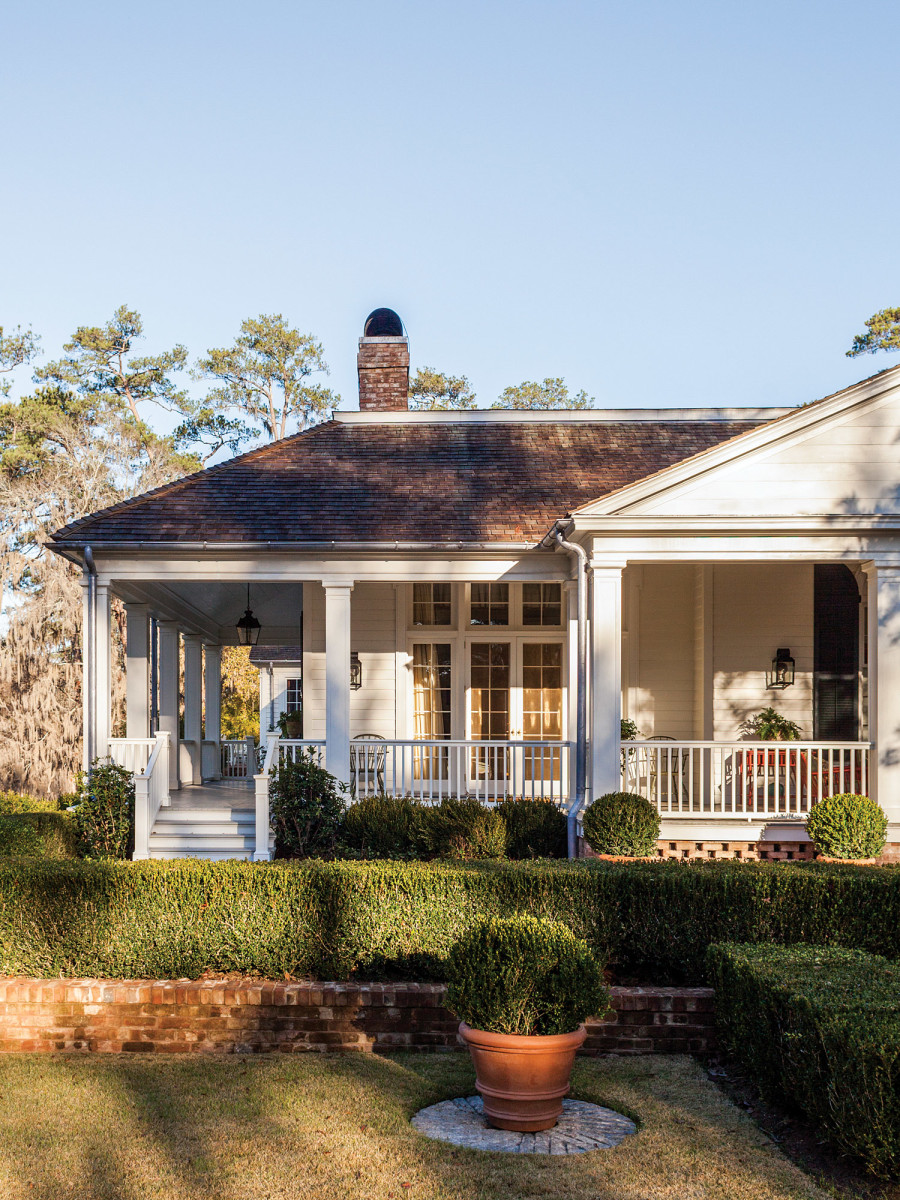 The one-story wrap-around porch has square columns and hipped roof on the 1840s wing.