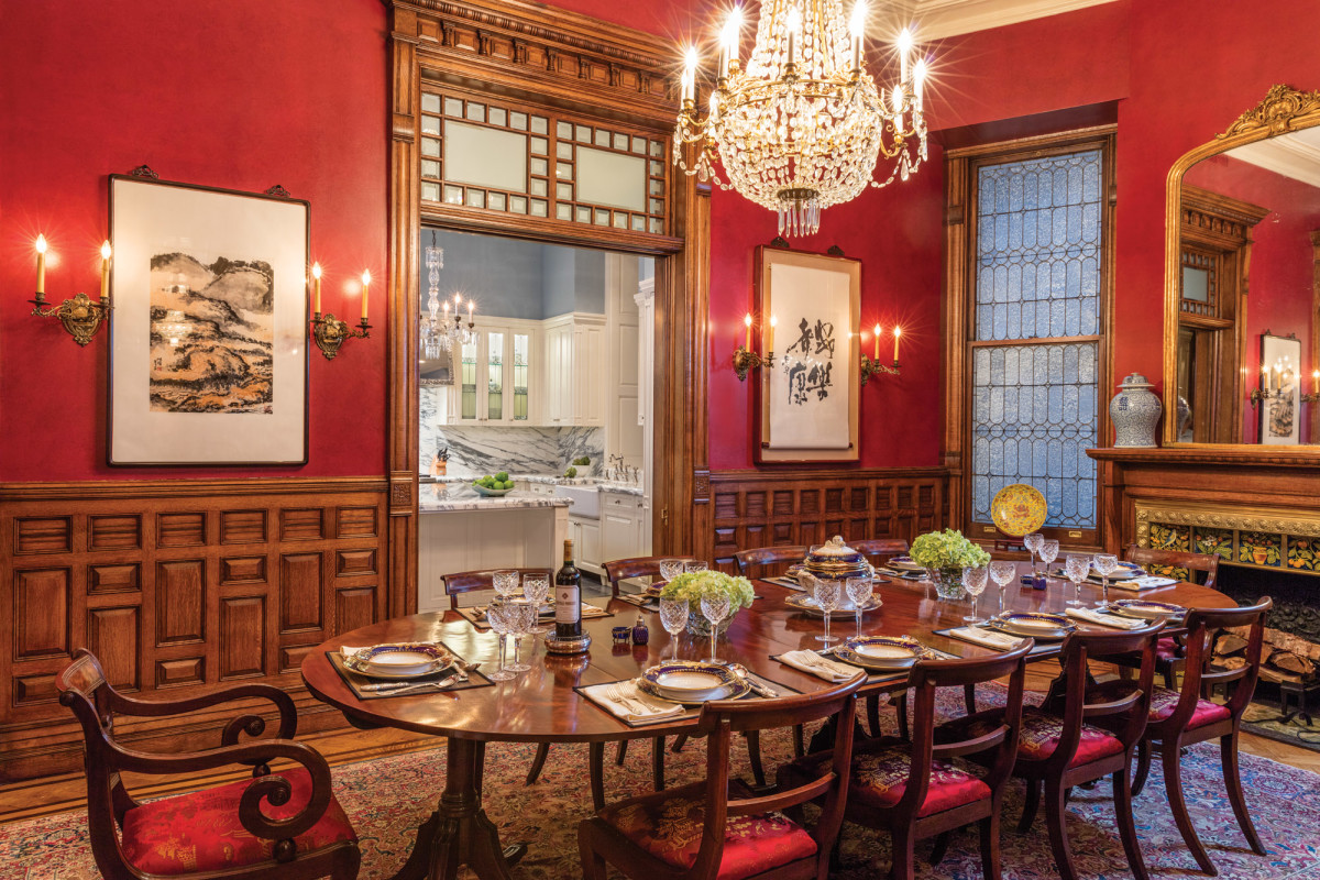In the dining room, the paneling is a careful blend of restored, repurposed, and recreated millwork, a necessity to accommodate new doorways in the enlarged space.