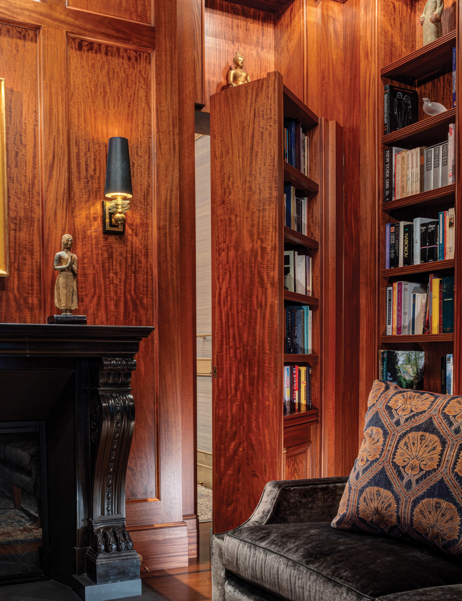Thisfigured Sapele bookcase in the study is also a secret door to a private washroom, beyond.